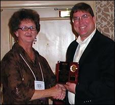 Chris Hopkins receives award on behalf of MHN